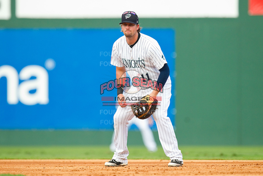 Charlotte Knights first baseman Andy Wilkins (11) on defense against the Durham Bulls at Knights Stadium on August 18, 2013 in Fort Mill, South Carolina.  The Bulls defeated the Knights 5-1 in Game Two of a double-header.  (Brian Westerholt/Four Seam Images)