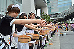 July 31st, 2011- Tokyo, Japan- Maid cosplayers sprinkling water: This summer, Japan is concerned for saving electricity due to the Fukushima nuclear plant disaster. Maids cos-players are doing water sprinkling to make the temperature cooler in Akihabara, Japan.(Photo by Yumeto Yamazaki/AFLO)