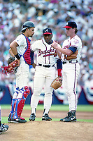 San Diego Padres catcher Benito Santiago with Atlanta Braves third baseman Terry Pendleton and pitcher Tom Glavine during the Major League Baseball All-Star Game at Jack Murphy Stadium  in San Diego, California.  (MJA/Four Seam Images)