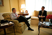 Washington, D.C. - July 20, 2005 -- United States President George w. Bush shares a meeting and coffeeoffee with Supreme Court Justice Nominee John Roberts in the residence of the White house in Washington, D.C. on July 20, 2005..Credit: Eric Draper - White House via CNP