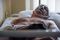 Igor Muryginn, a 42-year-old injured miner from the Zasyadko mine lies in a hospital in Donetsk, Ukraine, Wednesday, March 4, 2015.