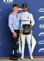 LEWIS HAMILTON (GBR) of Mercedes-AMG Petronas Motorsport celebrate his pole posison with Billy Monger during The Formula 1 2018 Rolex British Grand Prix at Silverstone Circuit, Northampton, England on 8 July 2018. Photo by Vince  Mignott.