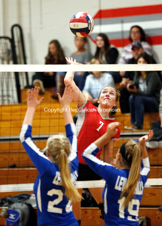 Winsted, CT- 09 November 2016-110916CM08-  Northwestern's Molly Clarke jumps up to spike the ball during their state tournament matchup against Lewis Mills' in Winsted on Wednesday.   Defender are Mills'  Caroline Kucia (24) and Alycia Fournier (19).     Christopher Massa Republican-American