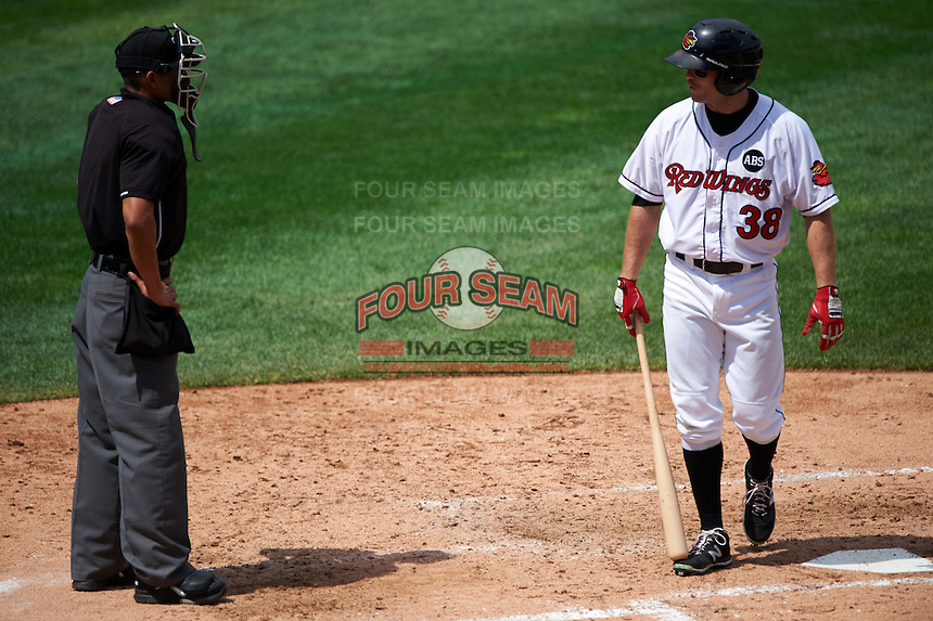 Rochester Red Wings third baseman Stephen Wickens (38) argues a strike three call by umpire Roberto Ortiz during a game against the Columbus Clippers on June 16, 2016 at Frontier Field in Rochester, New York.  Rochester defeated Columbus 6-2.  (Mike Janes/Four Seam Images)