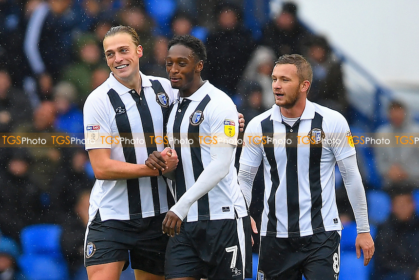 Tom Eaves of Gillingham left is congratulated on scoring the first goal by Brandon Hanlan and Dean Parrett of Gillingham during Portsmouth vs Gillingham, Sky Bet EFL League 1 Football at Fratton Park on 6th October 2018