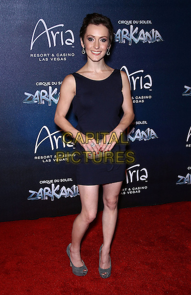 Erica Linz.Red Carpet Premiere of Zarkana by Cirque Du Soleil at Aria Resort and Casino, Las Vegas, Nevada, USA, .9th November 2012..full length navy blue dress clutch bag grey gray peep toe shoes .CAP/ADM/MJT.© MJT/AdMedia/Capital Pictures.