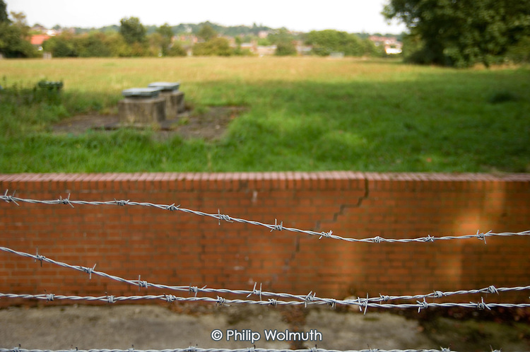 Padlocked open space on the site of a disused reservoir in West Hampstead, London, on which Thames Water wants to build 'luxury' flats, against the wishes of local residents. The company regards the land as a 'brownfield' site.