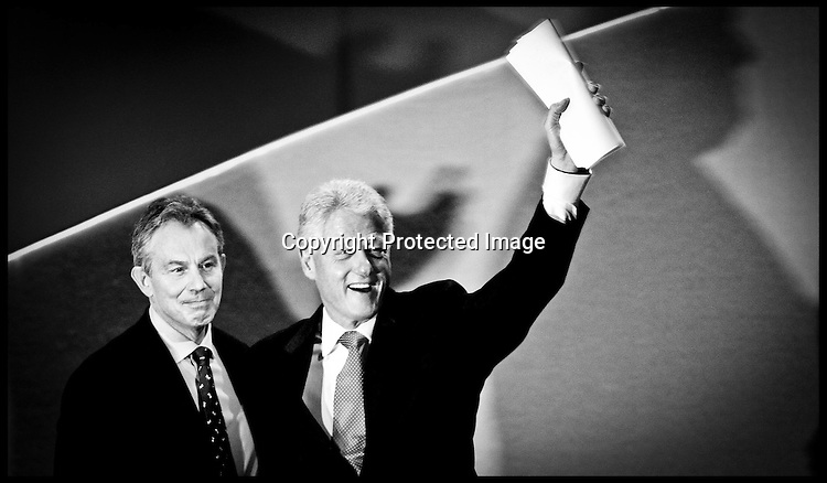 Prime Minister Tony Blair and Former US President Bill Clinton on stage after bill clintons  speech at the Labour Party Conference ,G-mex Centre,Manchester,PRESS ASSOCIATION Photo. Picture date:Wednesday 27th september , 2006. Photo credit should read: Andrew Parsons/PA.