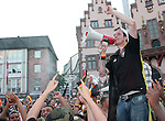 30 June 2006: A fan with a megaphone leads cheers as Germany fans celebrate in the town square in Frankfurt, site of several games during the FIFA 2006 World Cup. Germany had just defeated Argentina in a Quarterfinal game played in Berlin.