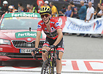 Race leader Simon Yates (GBR) Mitchelton-Scott crosses the finish line in 3rd place smiling as he knows he has won the overall at the end of Stage 20 of the La Vuelta 2018, running 97.3km from Andorra Escaldes-Engordany to Coll de la Gallina, Spain. 15th September 2018.                   <br /> Picture: Colin Flockton | Cyclefile<br /> <br /> <br /> All photos usage must carry mandatory copyright credit (© Cyclefile | Colin Flockton)