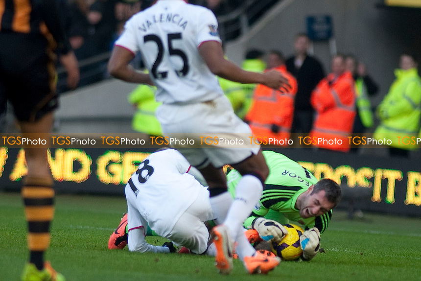 Yannick Sagbo of Hull City is dragged down<br />  - Hull City vs Manchester United - Barclays Premier League Football at the KC Stadium, Kingston upon Hull - 26/12/13 - MANDATORY CREDIT: Mark Hodsman/TGSPHOTO - Self billing applies where appropriate - 0845 094 6026 - contact@tgsphoto.co.uk - NO UNPAID USE