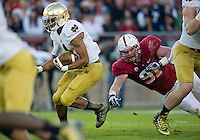George Atkinson III (4) gets by Stanford Cardinal defensive end Henry Anderson (91) in the first quarter.