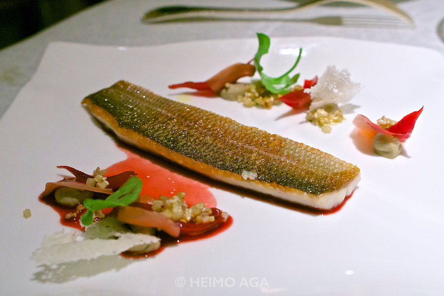 Vienna, Austria. The &quot;Steirereck&quot; with award winning Chef Heinz Reitbauer Junior is probably Vienna's best restaurant.<br /> Gebratene &Auml;sche mit Sesam, Poveraden &amp; Roseneibisch (Pan-fried Grayling with Sesame, Baby Artichokes and Rosemallow.)