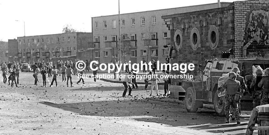 British soldiers shelter behind an armoured personnel carrier during rioting and stone-throwing in the Bogside area of Londonderry, N Ireland, 9th July 1971. The rioting was prompted by the deaths of two local men, Seamus Cusack and Desmond Beattie, who were shot by soldiers in disputed circumstances. 197107090261c<br /> <br /> Copyright Image from Victor Patterson, 54 Dorchester Park, Belfast, UK, BT9 6RJ<br /> <br /> Tel: +44 28 9066 1296<br /> Mob: +44 7802 353836<br /> Voicemail +44 20 8816 7153<br /> Email: victorpatterson@me.com<br /> Email: victorpatterson@gmail.com<br /> <br /> IMPORTANT: My Terms and Conditions of Business are at www.victorpatterson.com