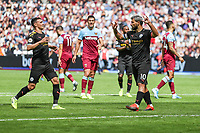 GOAL - Sergio Aguero of Manchester City (10) celebrates after he scores from the penalty spot to make the score 0-4 during the Premier League match between West Ham United and Manchester City at the London Stadium, London, England on 10 August 2019. Photo by David Horn.
