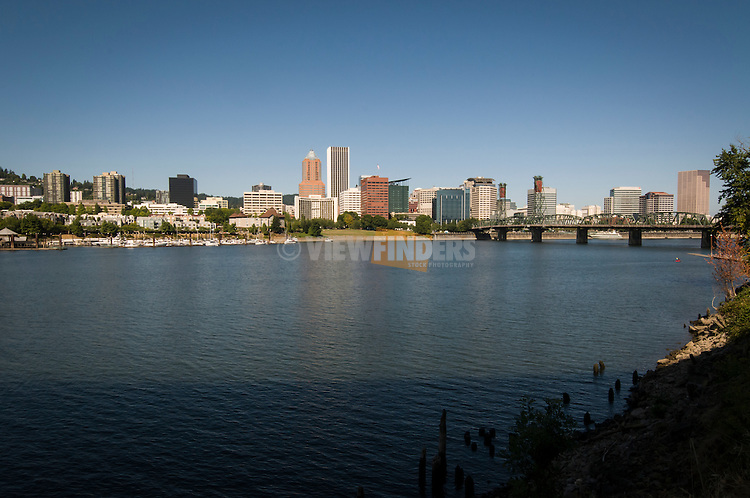 Portland cityscape with the Willamette River in the foreground.