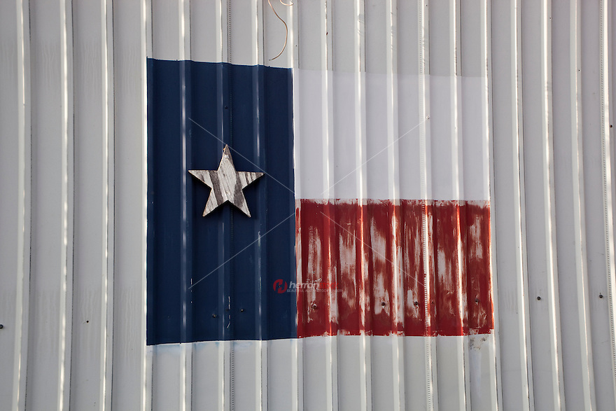 View of front of an old building with State Flag of Texas painted on it