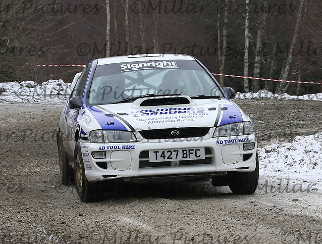 Mark McCulloch - Elliott Edmondson at junction 4 on Special Stage 2 Wauchope on the Brick & Steel Border Counties Rally 2013, Round 2 of the RAC MSA Scottish Rally Championship sponsored by ARR Craib Transport Limited which was organised by Whickham & District and Hawick & Border Car Clubs and based in Jedburgh and held in Kielder Forest on 23.3.13.