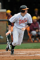 Tennessee Volunteers designated hitter Andrew Lee #24 swings at a pitch during a game against  the Arizona State Sun Devils at Lindsey Nelson Stadium on February 23, 2013 in Knoxville, Tennessee. The Volunteers won 11-2.(Tony Farlow/Four Seam Images).