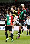 Nederland, Nijmegen, 3 februari 2013.Eredivisie .Seizoen 2012-2013.N.E.C.-Vitesse.Mike Havenaar van Vitesse poging tot een doorbraak in het strafschopgebied van N.E.C. mislukt nadat Michel Breuer van N.E.C. de bal weg kopt. V.l.n.r.: Remy Amieux van N.E.C., Mike Havenaar van Vitesse, Ryan Koolwijk van N.E.C., Michel Breuer van N.E.C. en scheidsrechter Bjorn Kuipers