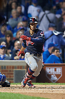 Cleveland Indians Francisco Lindor (12) hits a single in the fourth inning during Game 3 of the Major League Baseball World Series against the Chicago Cubs on October 28, 2016 at Wrigley Field in Chicago, Illinois.  (Mike Janes/Four Seam Images)