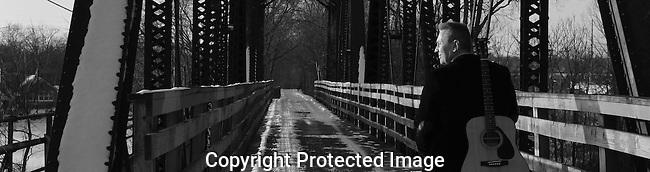 "Album banner for Steve Larsen's ""Beyond Belief"". The retired railroad bridge displays the artist's path to spirituality. Album copyright 2012 Steve Larsen."