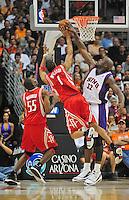 Mar. 22, 2008; Phoenix, AZ, USA; Phoenix Suns center (32) Shaquille O'Neal blocks the shot of Houston Rockets guard (1) Tracy McGrady at the US Airways Center. Mandatory Credit: Mark J. Rebilas