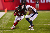 Canton, Ohio - August 1, 2019: Atlanta Falcons running back Brian Hill #23 incurs a penalty for head to head contact with Denver Broncos defensive back Dymonte Thomas #35 during a pre-season game at the Tom Benson Hall of Fame stadium in Canton, Ohio August 1, 2019. This game marks start of the 100th season of the NFL. (Photo by Don Baxter/Media Images International)