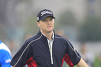 Michael Hoey (NIR) sinks his putt on the 14th green during Friday's Round 2 of the 2014 BMW Masters held at Lake Malaren, Shanghai, China 31st October 2014.<br /> Picture: Eoin Clarke www.golffile.ie