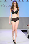 Model walks runway in lingerie from Natori + Support, during the Lingerie Fashion Night - Romancing The Runway show, by CurvExpo and Lycra on February 23, 2015.