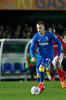 Joe Piggott of AFC Wimbledon runs with the ball during the Sky Bet League 1 match between AFC Wimbledon and Charlton Athletic at the Cherry Red Records Stadium, Kingston, England on 10 April 2018. Photo by Carlton Myrie / PRiME Media Images.