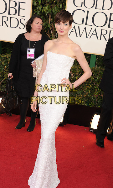 Anne Hathaway.Arrivals at the 70th Annual Golden Globe Awards held at the Beverly Hilton Hotel, Hollywood, California, USA..January 13th, 2013.globes full length white strapless dress peplum hand on hip.CAP/GAG.©GAG/Capital Pictures
