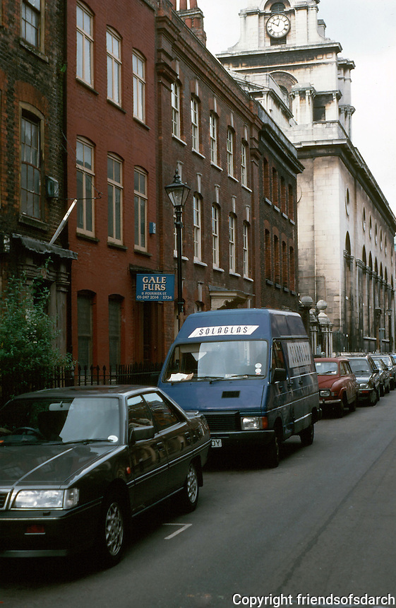 London:  Spitalfields.  Fournier St. behind Christ church--the least affected housing stock in the East End--all early 18th century.  Photo '90.