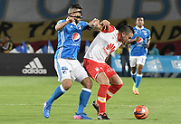 BOGOTA - COLOMBIA -19 -03-2017: Andres Cadavid (Izq) jugador de Millonarios disputa el balón con Denis Stracqualursi (Der) jugador de Independiente Santa Fe durante partido  partido por la fecha 10 de la Liga Aguila I 2017 jugado en el estadio Nemesio Camacho El Campin de la ciudad de Bogota./ Andres Cadavid (L) player of Millonarios fights for the ball with Denis Stracqualursi (R) player of Independiente Santa Fe during match for the date 10 of the Liga Aguila I 2017 played at the Nemesio Camacho El Campin Stadium in Bogota city. Photo: VizzorImage / Gabriel Aponte / Staff.