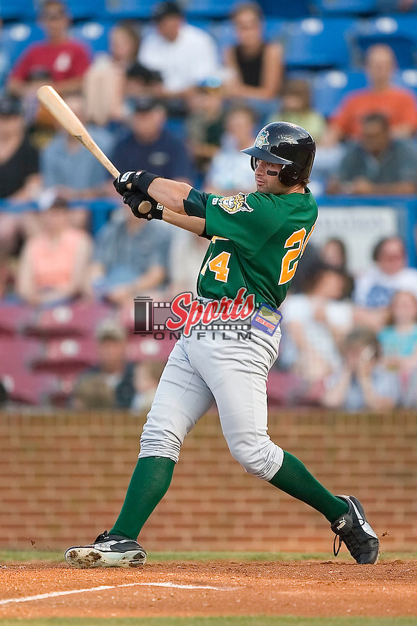 Lynchburg designated hitter Neil Walker (24) follows through on his swing versus Winston-Salem at Ernie Shore Field in Winston-Salem, NC, Saturday, June 3, 2006.  Winston-Salem defeated Lynchburg 3-2.