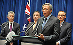 Singapore Defence Minister Dr Ng Eng Hen speaks at a press conference with Australian Defence Minister Stephen Smith, (L) Trade Minister Craig Emerson (LC) and Foreign Minister Bob Carr (R) at Parliament House Canberra, Monday September 10th 2012. AFP PHOTO / Mark GRAHAM