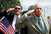 """Ed Callahan of Philadelphia, PA (right) salutes during the playing of the National Anthem during a Celebration of America on the South Lawn of the White House, in Washington, D.C. on June 5, 2018. The President came-up with this event after he uninvited the Super Bowl Champion Philadelphia Eagles to the White House for the traditional Presidential celebration.  In a statement, the President said """"They disagree with their President because he insists that they proudly stand for the National Anthem, hand on heart, in honor of the great men and women of our military and the people of our country.  The Eagles wanted to send a smaller delegation, but the 1,000 fans planning to attend the event deserve better.""""<br /> Credit: Martin H. Simon / CNP"""