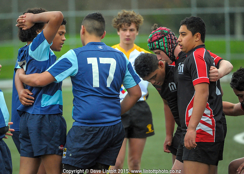 Action from the Hurricanes under-15 rugby tournament match between Naenae College (blue) and Manukura (black and red) at Maidstone Park Artificial Turf, Upper Hutt, Wellington, New Zealand on Tuesday,1 September 2015. Photo: Dave Lintott / lintottphoto.co.nz