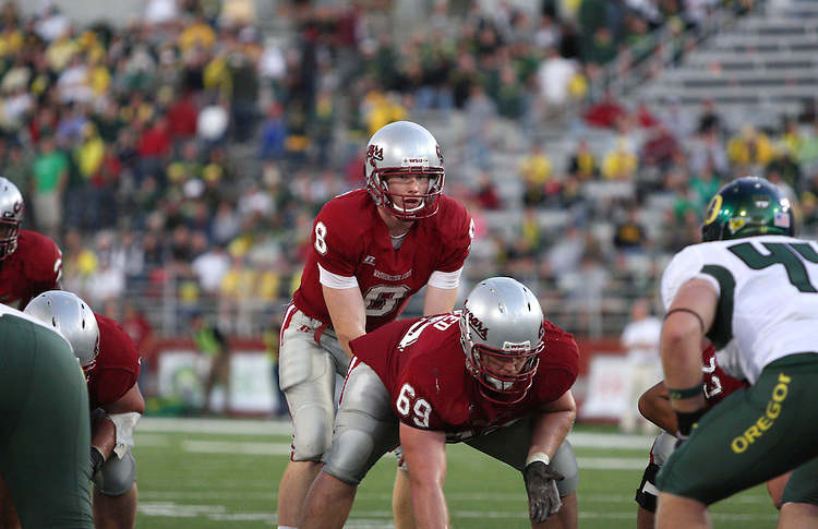 Marshall Lobbestael (#8), Washington State University quarterback, prepares to take the snap from center during the Cougars Pac-10 conference football game against the Oregon Ducks in Pullman, Washington, on September 27, 2008,  Lobbestael, a redshirt freshman, threw two touchdown passes in the game, but the Ducks prevailed 63-14.