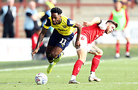 Oxford United's Tariqe Fosu is goes down under the challenge from Fleetwood Town's Wes Burns<br /> <br /> Photographer Rich Linley/CameraSport<br /> <br /> The EFL Sky Bet League One - Fleetwood Town v Oxford United - Saturday 7th September 2019 - Highbury Stadium - Fleetwood<br /> <br /> World Copyright © 2019 CameraSport. All rights reserved. 43 Linden Ave. Countesthorpe. Leicester. England. LE8 5PG - Tel: +44 (0) 116 277 4147 - admin@camerasport.com - www.camerasport.com