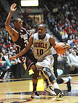 "Mississippi's LaDarius White (10) drives against Mississippi State's Craig Sword (32) at the C.M. ""Tad"" Smith Coliseum on Wednesday, February 6, 2013. (AP Photo/Oxford Eagle, Bruce Newman).."
