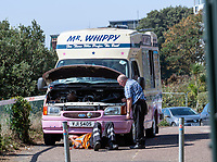 BNPS.co.uk (01202 558833)<br /> Pic: PhilYeomans/BNPS<br /> <br /> Too sticky for Mr Whippy...<br /> <br /> The RAC were called out to an ice cream van on the East cliff in Bournemouth that had expired in the heat.