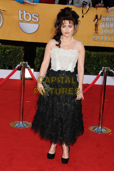HELENA BONHAM CARTER.17th Annual Screen Actors Guild Awards held at The Shrine Auditorium, Los Angeles, California, USA..January 30th, 2011.SAG arrivals full length dress black skirt white flowers sheer straps pearls beaded clutch bag slogan writing pearls of wisdom lulu guinness platform shoes .CAP/ADM/BP.©Byron Purvis/AdMedia/Capital Pictures.