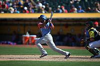 """OAKLAND, CA - AUGUST 26:  Elvis Andrus #1 of the Texas Rangers bats against the Oakland Athletics during the game at the Oakland Coliseum on Saturday, August 26, 2017 in Oakland, California. Note: both teams are wearing special colorful uniforms for """"Players Weekend"""" that also include nicknames on the backs of their jerseys. (Photo by Brad Mangin)"""