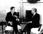"United States President Ronald Reagan, left, and German Chancellor Helmut Schmidt, right, meet in the Oval office of the White House in Washington, DC shortly before a working lunch on January 5, 1982.  Schmidt expressed alarm at the high interest rates in the US but it is expected he will back the President on Poland and be critical of the Soviet Union and their intervention in that country.  Helmut Schmidt passed away on November 10, 2015 at age 96.<br /> Credit: Benjamin E. ""Gene"" Forte / CNP"