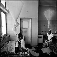 Huambo, Angola, May, 24, 2006.Babena, 25, left with Sabina, 36, right. More than 300 TB patients live in Huambo State Sanatorium, hundreds more are outside patients. TB is endemic in the region, fueled by poverty, malnutrition, inadequate hygiene and the rapid spreading of HIV/AIDS since the end of the civil war in 2002.