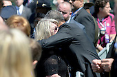 United States President Barack Obama greets families of falling police officer at the National Peace Officers Memorial Service, an annual ceremony honoring law enforcement who were killed in the line of duty in the previous year, at the US Capitol in Washington, DC, May 15, 2015. <br /> Credit: Olivier Douliery / Pool via CNP