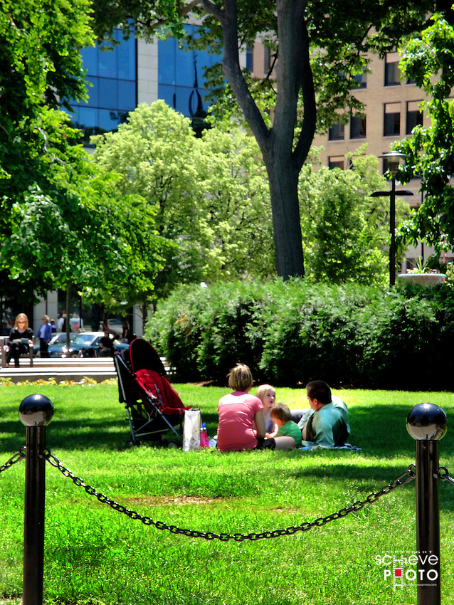 A family enjoys a picnic lunch on Wisconsin's State Capitol grounds in Madison.
