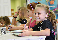 NWA Democrat-Gazette/CHARLIE KAIJO Elliot Childers, 6, of Bentonville (right) reacts while working on an art project during an art camp, Monday, August 5, 2019 at Imagine Studios in Rogers.<br /> <br /> Imagine Studios owner Melanie Hewins held an art camp called Unicorn Dreams. Kids decorated unicorn themed plates and unicorn and rainbow magnets. The camp runs till Thursday. Kids learn how to use acrylic paints and water colors and canvas and ceramic painting.
