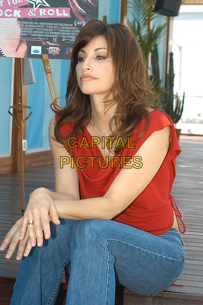 GINA GERSHON.Prey for Rock N Roll photocall.May 31st, 2004.half length, half-length, red top, sitting, sleeveless.www.capitalpictures.com.sales@capitalpictures.com.© Capital Pictures.